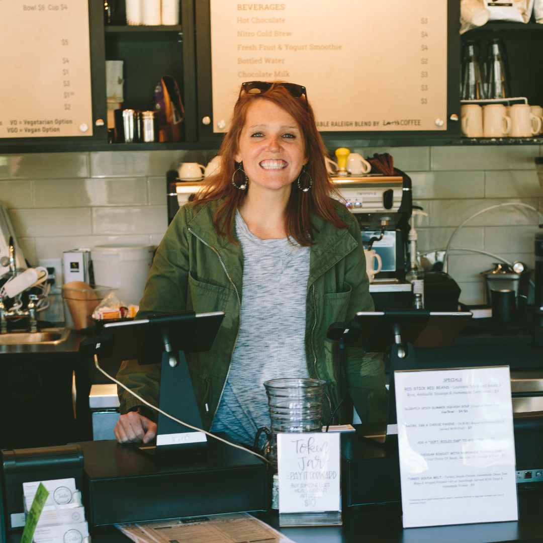 Maggie Kane, a beautiful lady with red hair at her coffee shop