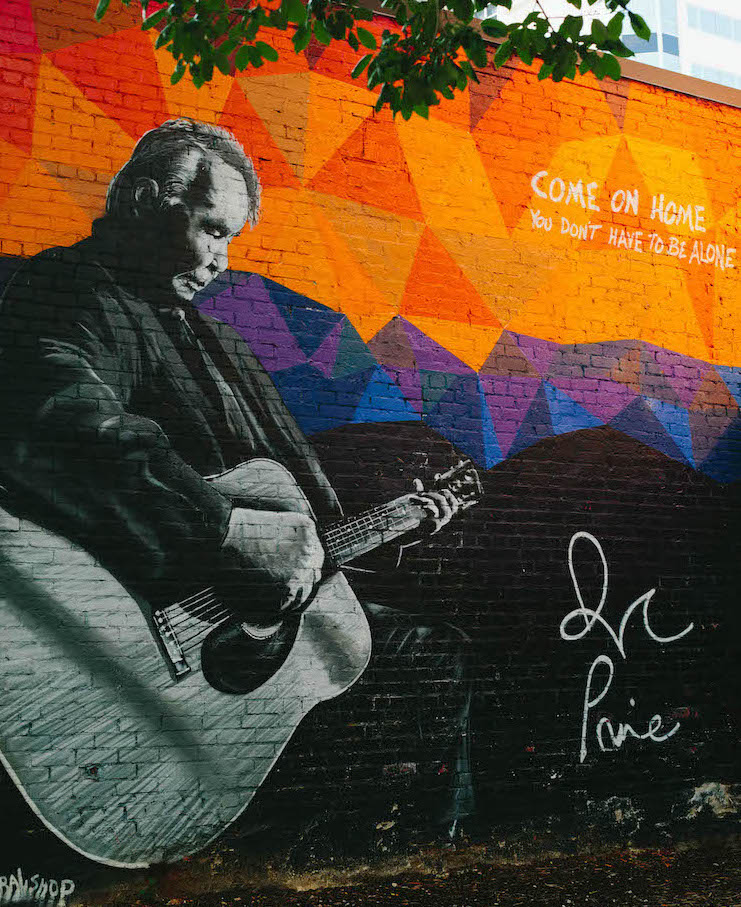 "Old man on guitar and quote that reads ""Come on home, you don't have to be alone."""